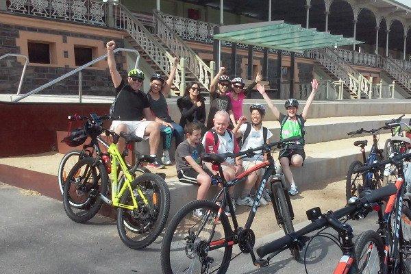bike tour group taking a break at historic landmark in adelaide city
